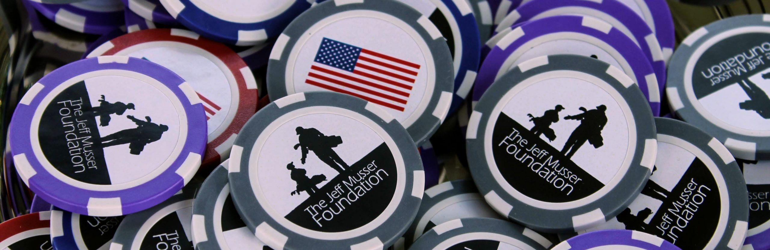 Ball markers with Jeff Musser Foundation logo